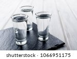 three vodka shots with ice on...   Shutterstock . vector #1066951175