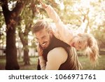 cheerful father holding his... | Shutterstock . vector #1066971761