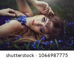 girl with long hair and blue... | Shutterstock . vector #1066987775