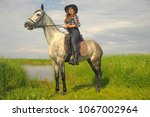 girl in plaid shirt and cowboy... | Shutterstock . vector #1067002964