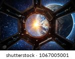 earth and galaxy in spaceship... | Shutterstock . vector #1067005001