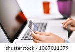 unrecognizable person shopping... | Shutterstock . vector #1067011379