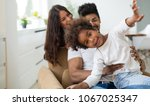 picture of happy family... | Shutterstock . vector #1067025347