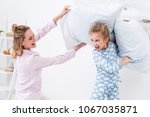 screaming mother and daughter...   Shutterstock . vector #1067035871