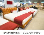 abstract blurred bed for sale... | Shutterstock . vector #1067044499