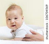 Adorable baby girl looking at camera . - stock photo
