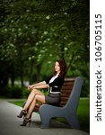 young beautiful girl sitting on bench - stock photo
