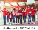 group of fans dressed in red... | Shutterstock . vector #1067069135