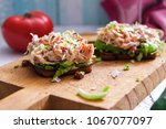 bruschetta with crab salad... | Shutterstock . vector #1067077097