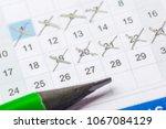 closeup of dates on calendar...   Shutterstock . vector #1067084129