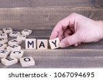 may. wooden letters on the... | Shutterstock . vector #1067094695
