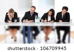 Group of business people taking notes at the meeting - stock photo
