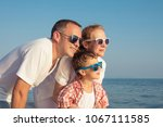 happy family standing on the... | Shutterstock . vector #1067111585