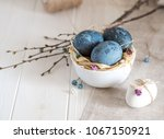 blue  and white easter eggs.... | Shutterstock . vector #1067150921