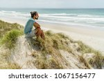 lonely thoughtful man sitting... | Shutterstock . vector #1067156477