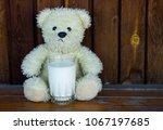teddy bear with milk drain on... | Shutterstock . vector #1067197685
