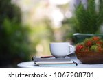 white cup and notebooks with... | Shutterstock . vector #1067208701