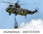 Small photo of Yeovilton, Somerset, UK - July 8, 2011: A Westland Sea King HC4, ZE425/ WR, carries an underslung load at an airshow