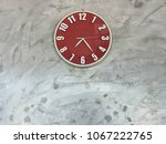 decoration of red clock on the... | Shutterstock . vector #1067222765