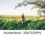 the guy goes by the bike in the ...   Shutterstock . vector #1067233991