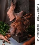 Pig Head With Carrots
