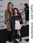 "LOS ANGELES, CA - FEBRUARY 8, 2011: Miley Cyrus & sister Noah Cyrus at the Los Angeles premiere of ""Justin Bieber: Never Say Never"" at the Nokia Theatre LA Live. February 8, 2011  Los Angeles, CA - stock photo"