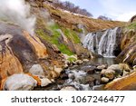 the steam from geysers. river... | Shutterstock . vector #1067246477