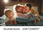 evening family reading. father... | Shutterstock . vector #1067248097