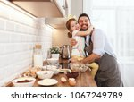 happy family in kitchen. father ... | Shutterstock . vector #1067249789