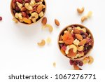 healthy snack  mixed nuts and... | Shutterstock . vector #1067276771