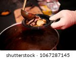 pouring gravy on roast beef and ... | Shutterstock . vector #1067287145