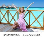 young beautiful girl stands in... | Shutterstock . vector #1067292185