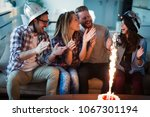 group of friends enjoying and... | Shutterstock . vector #1067301194