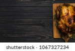 roasted chicken fillet on aged... | Shutterstock . vector #1067327234