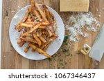 homemade truffle french fries... | Shutterstock . vector #1067346437