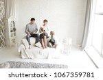 portrait of happy parents with... | Shutterstock . vector #1067359781