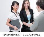 business partners shake hands... | Shutterstock . vector #1067359961