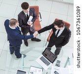 business partners shake hands... | Shutterstock . vector #1067361089