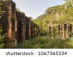 roman aqueduct abadoned  in the ... | Shutterstock . vector #1067365334