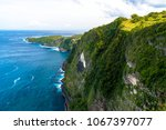 kelingking cliff  nusa penida ... | Shutterstock . vector #1067397077