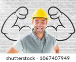 happy worker with hat in front... | Shutterstock . vector #1067407949