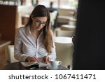young student reading a book | Shutterstock . vector #1067411471
