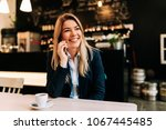 portrait of a smiling business... | Shutterstock . vector #1067445485