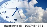 clock face in blue sky. time... | Shutterstock . vector #1067454941