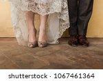 bride and groom's feet standing ... | Shutterstock . vector #1067461364