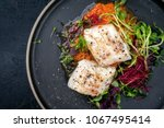 steamed cod fish filet with... | Shutterstock . vector #1067495414
