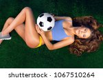 sexy cheerleader with a soccer... | Shutterstock . vector #1067510264