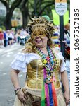 Small photo of New Orleans, LA/USA - February 10, 2018: A parade attendee strikes a pose while waiting for the Krewe of Iris and the Krewe of Tucks parades to roll down St. Charles Ave. in New Orleans, LA.