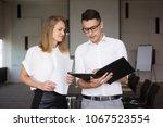 confident executive explaining... | Shutterstock . vector #1067523554