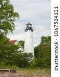 the point iroquois lighthouse... | Shutterstock . vector #1067524121